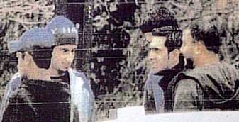 A surveillance photo of Shehzad Tanweer (second to the left), Mohammad Sidique Khan (far right), and Omar Khyam (center), taken in the parking lot of a McDonald's restaurant on February 28, 2004.