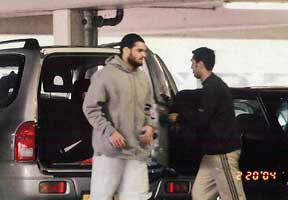 A surveillance photo of Momin Khawaja (in grey sweater) and unidentified man on February 20, 2004.