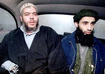 Abu Hamza al-Masri (left) riding in a car with Haroon Rashid Aswat in January 1999.