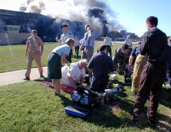 Medical workers at the first triage area set up outside the Pentagon after it is attacked.