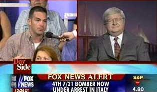 John Loftus (right) is asked a question from an audience member while on Fox News on July 29, 2005.