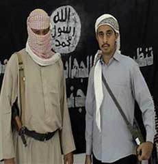 Ahmed al-Mashjari (right) with unidentified associate, in propaganda video.