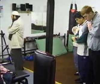 Ronson's footage of Omar Bakri Mohammed, left, leading followers in prayer inside the Scout hut.