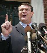 Hatfill holding a press conference on August 11, 2002.