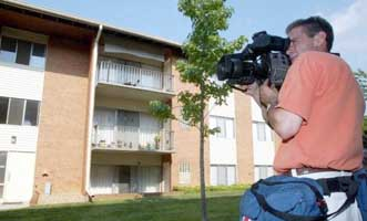A television film crew at Steven Hatfill's apartment on August 1, 2002.