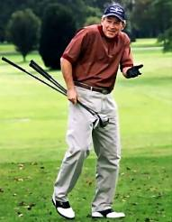 Bush playing golf, presumably before August 19, 2003.