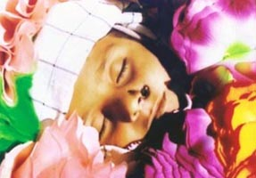 An eight year old boy killed by a drone strike in Makeen, South Waziristan. He is covered in flowers for his funeral.