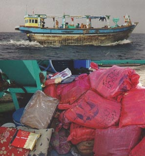 Bags of hashish, below, found on the fishing boat, above, in the Arabian Sea in December 2003.