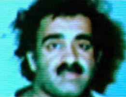 Khalid Shaikh Mohammed shortly after arrest. (Note: this picture is from a video presentation on prisoners the Pakistani government gave to BBC filmmakers. It has been adjusted to remove some blue tinge.)