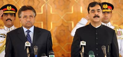 President Musharraf swearing in Yousaf Raza Gillani as Pakistan's latest prime minister.