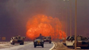 A roadside bomb detonates on an Iraqi highway.