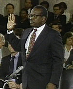 Clarence Thomas survives the Senate hearings to join the Supreme Court.
